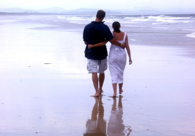 Man and woman walking together on Australian beach