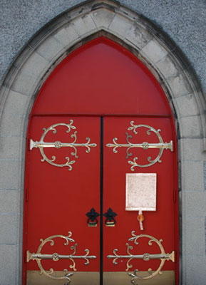 Red church doors with a copy of Magna Carta nailed to the door as the Archbishop had ordered