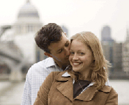 Couple kissing in front of St Paul's