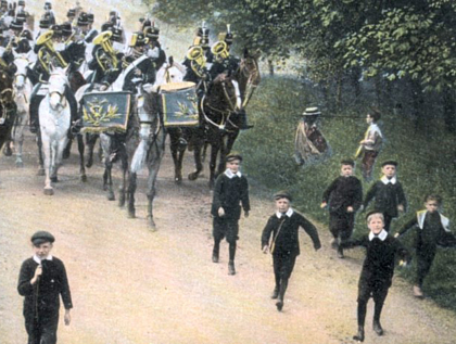 19th century schoolboys larking with King's Hussars