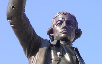 Statue of Burke with bullet holes