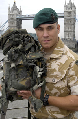 Lance Corporal Croucher and blown-up rucksack