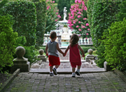 Two small children entering garden hand in hand