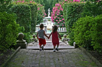 Small children approach a garden