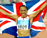 Kelly Holmes winning Olympics and carrying British flag