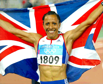 Kelly Holmes carrying the Union flag after winning gold at the 2004 Olympics