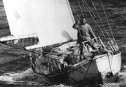 Knox-Johnston standing on his ketch in heavy seas