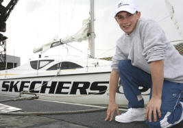 Boy on deck of sailing boat