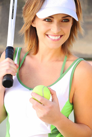 Smiling woman with tennis racquet