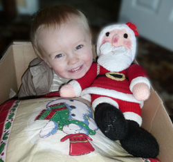 Little boy smiling in Christmas box